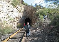 Austin poses in front of a railroad tunnel
