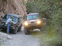 Frank negotiates a tight squeeze thanks to inconsiderate hikers parking their vehicles.